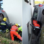 Car gets wedged upside down between a house and a wall