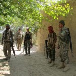 Afghan forces battle to hold off Taliban in Helmand district